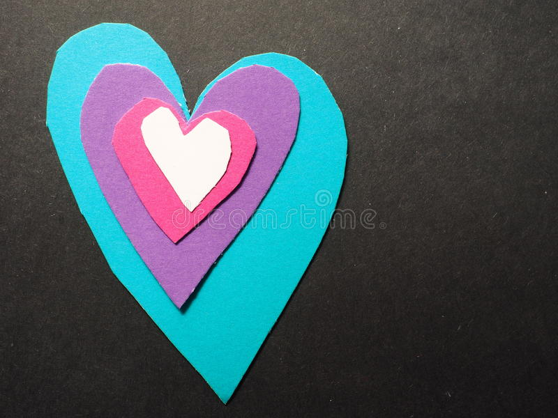 Heart layers. Real cut out of paper hearts for your romantic or healthcare copy - lots of copy space to the right royalty free stock photo