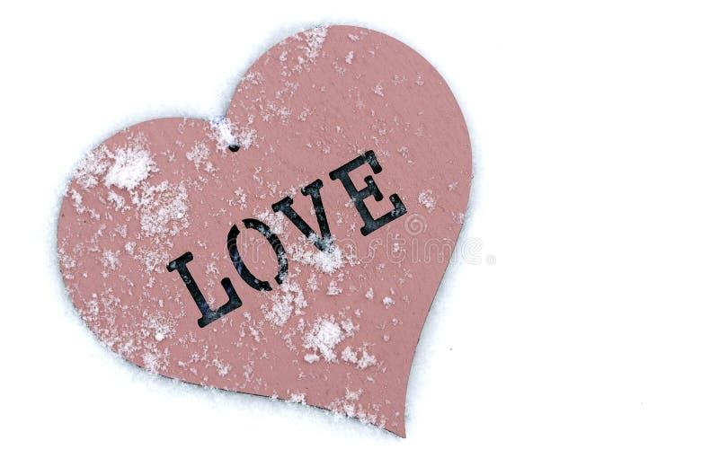 The heart lies on the snow. stock photos