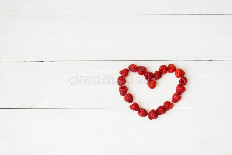 Heart lined from the berries royalty free stock images
