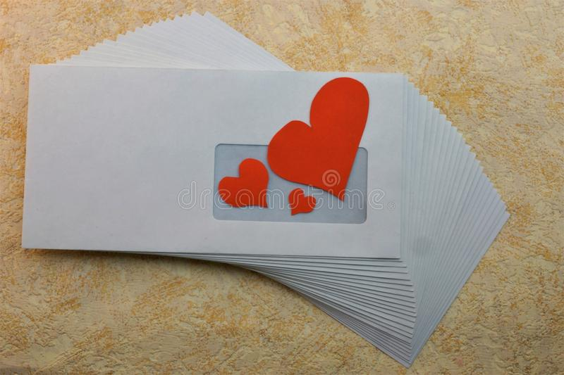 Heart with love through the mail in an envelope. Loyalty respect understanding patience reciprocity liking the beauty of an intimate attachment royalty free stock photo