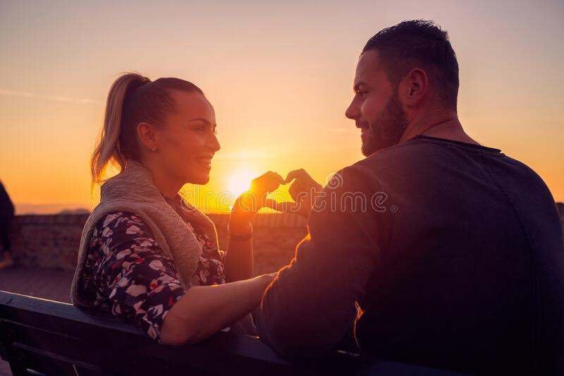 Heart and love.Man and woman in Love at evening enjoying time together stock photo
