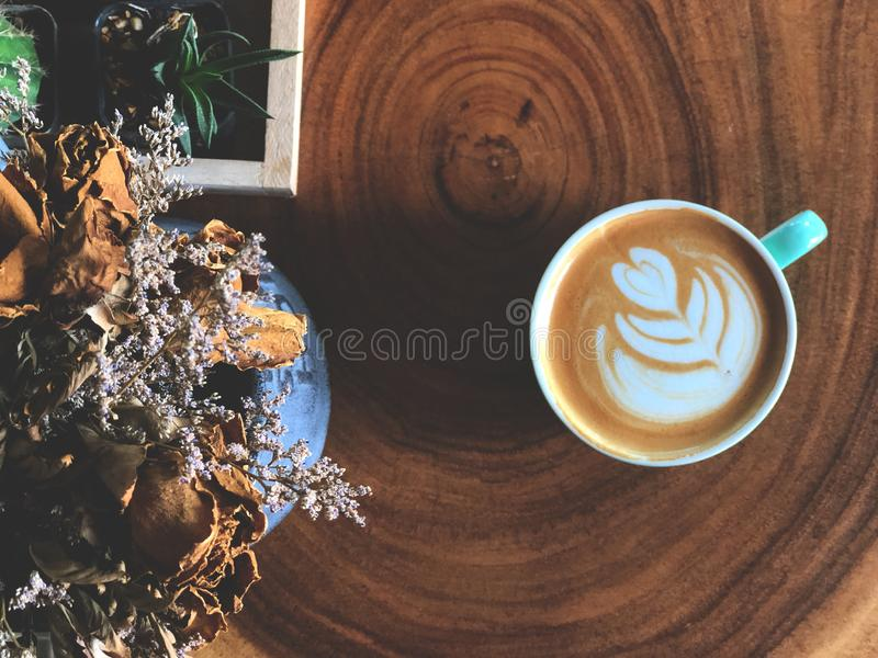 Heart love shape latte art on the wooden table , vintage style, coffee lover . Serving size.heart love shape latte art on the wooden table , vintage style royalty free stock photography