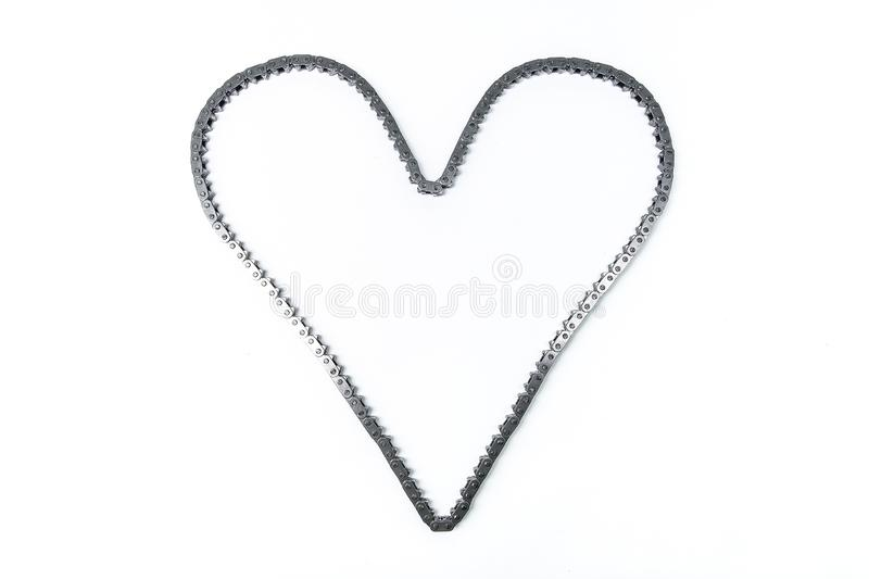 Heart made of car engine chain on a white background. royalty free stock photo