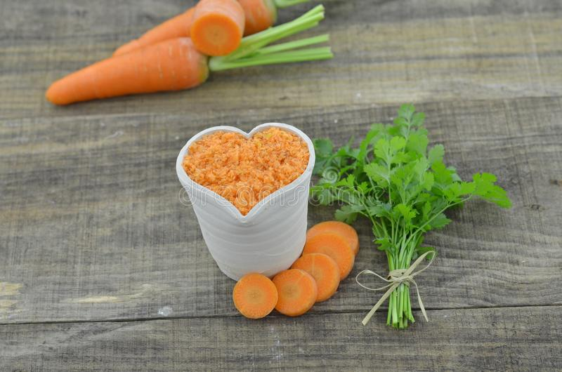 heart made by carrot bowl on wooden stock image