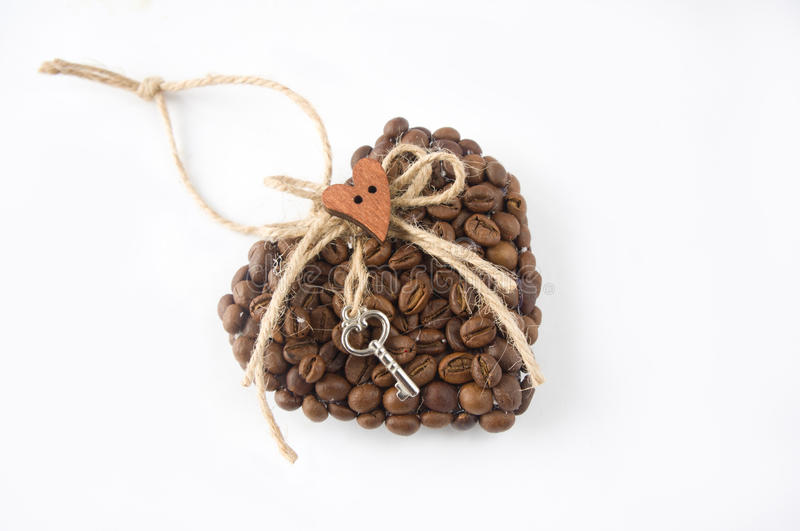 Heart made of coffee beans. Valentine`s Day. Handicraft royalty free stock photography