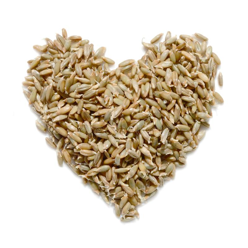 Heart made from grain isolated on white background stock photos