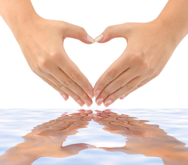 Heart made of hands and water stock photography