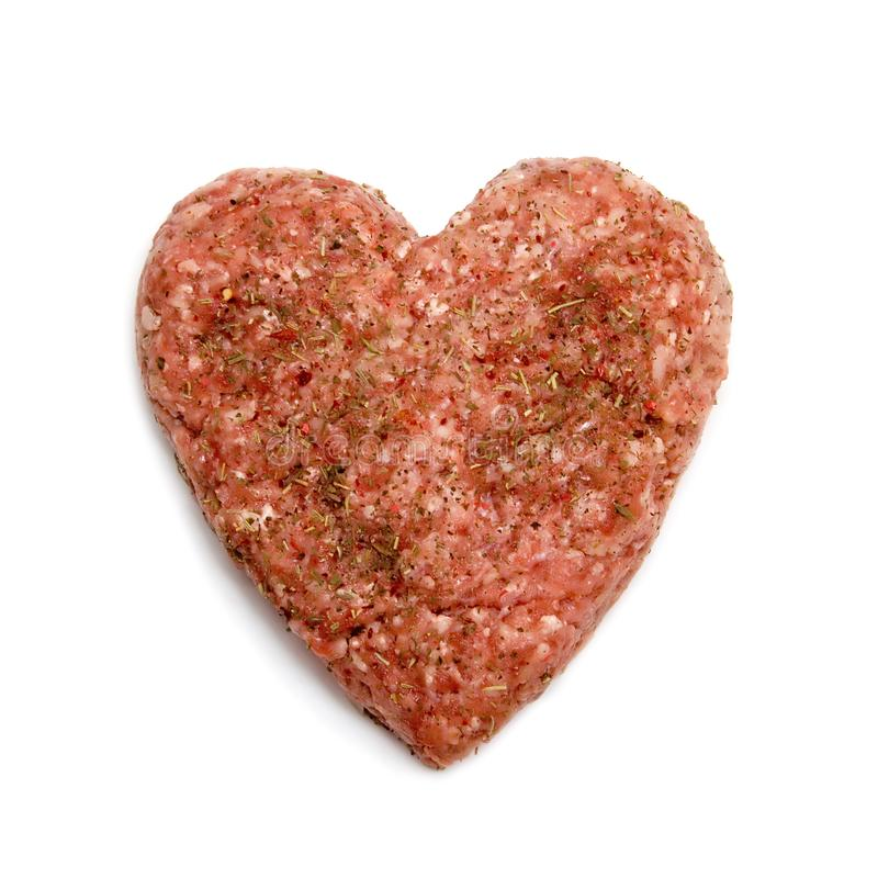 Heart made of minced meat stock images