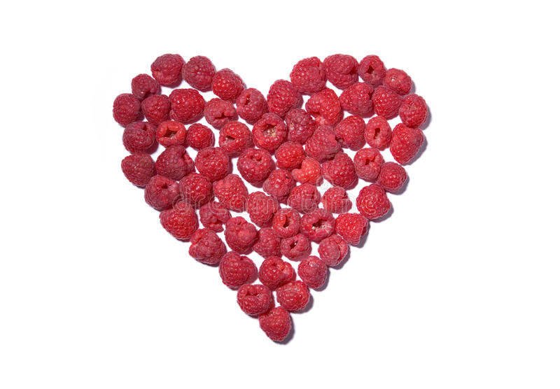 Heart made out of raspberries royalty free stock photography