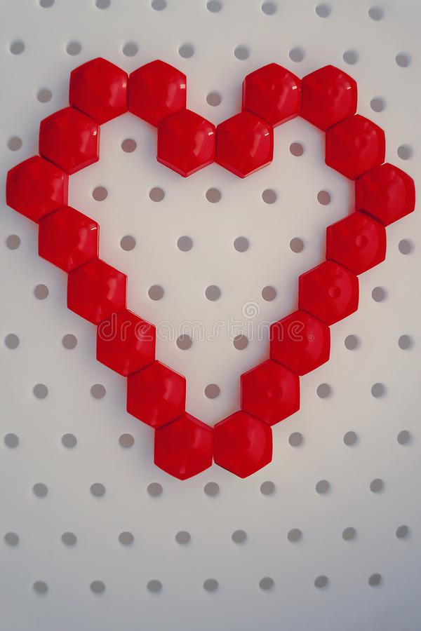 Heart made from red pieces of puzzles on white royalty free stock photos