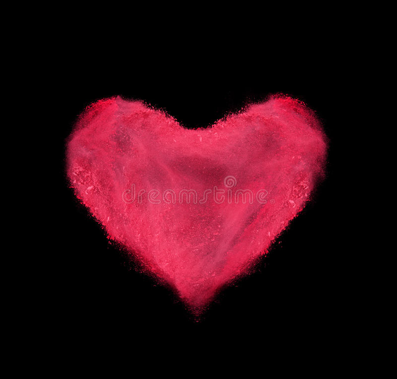 Heart made of red powder explosion on black royalty free stock photo