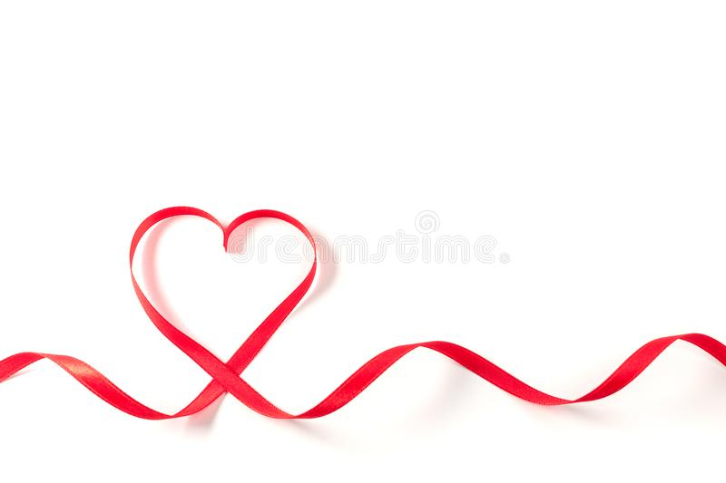 Heart made of ribbon on white background. stock image