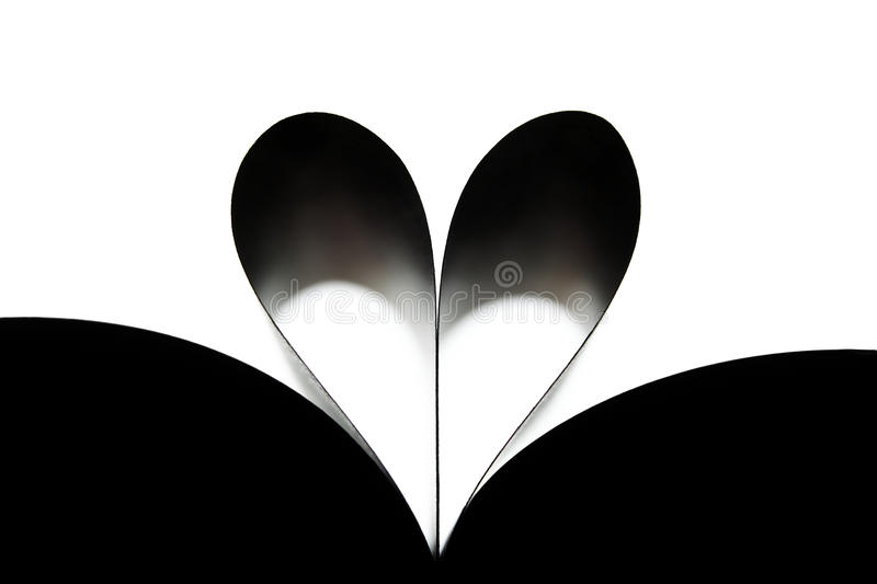 Heart made of rolled up book's sheets royalty free stock photo