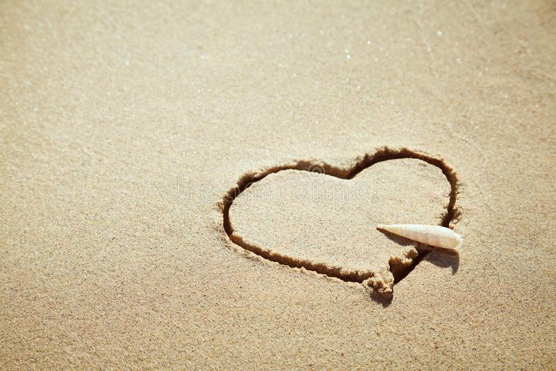 Heart made of sand on the beach. Love concept. royalty free stock images