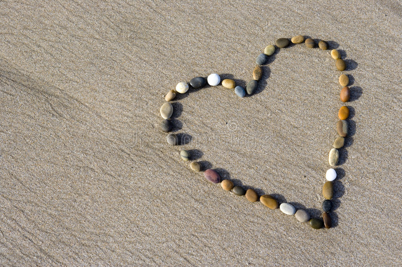 Download Heart Made With Small Stone In The Sand Stock Photo - Image: 4962700