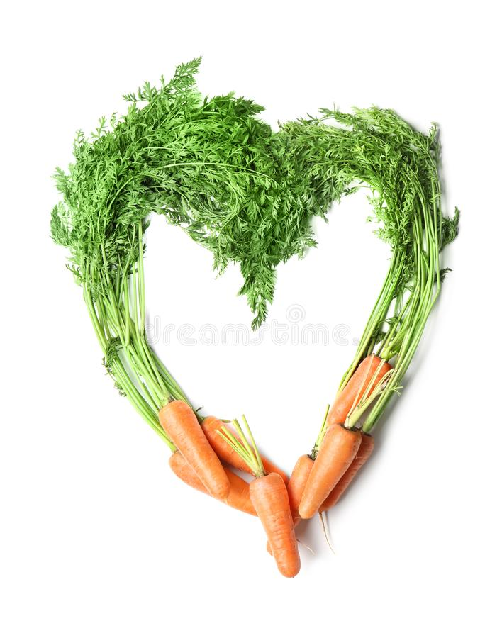 Heart made of tasty ripe carrots royalty free stock photos