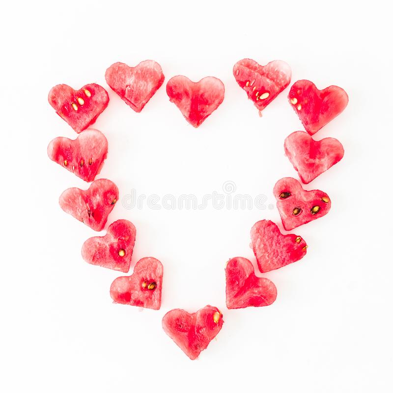 Heart made of watermelon. Flat lay love composition on white background. Top view. Valentine`s day royalty free stock photos