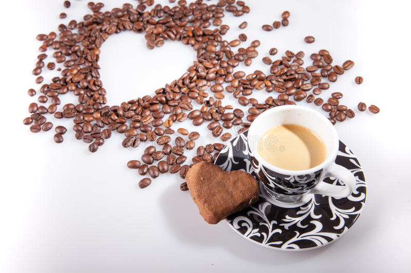 Download Heart Make Whit Coffee Beans And Cup Whit Espresso And Sweet Heart Cookie On White Table Background. Stock Image - Image: 83722689