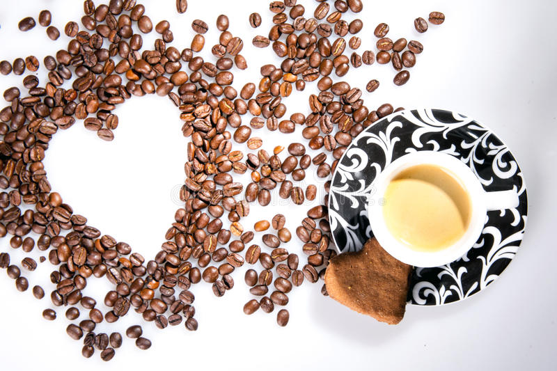 Download Heart Make Whit Coffee Beans And Cup Whit Espresso And Sweet Heart Cookie On White Table Background. Stock Photo - Image: 83722780