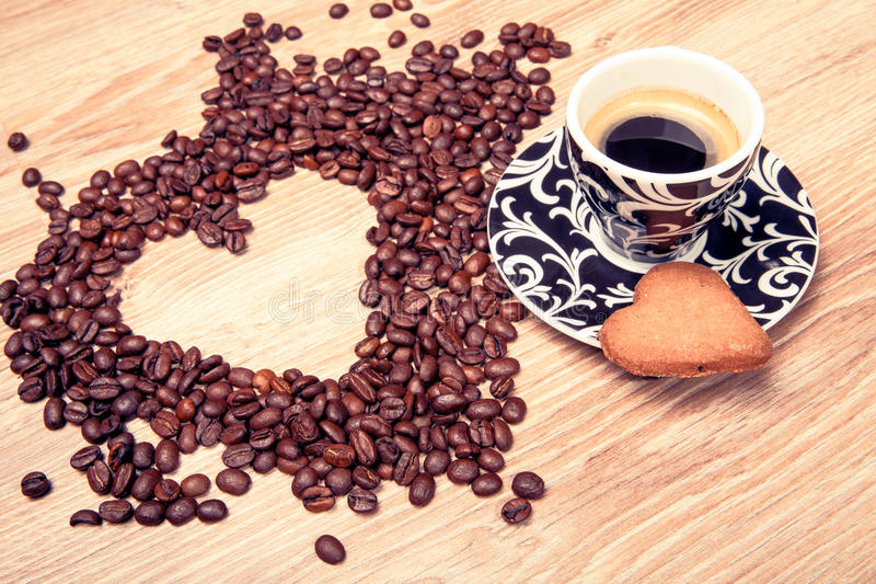 Download Heart Make Whit Coffee Beans And Cup Whit Espresso And Sweet Heart Cookie On Wood Table Background. Stock Photo - Image: 83722594