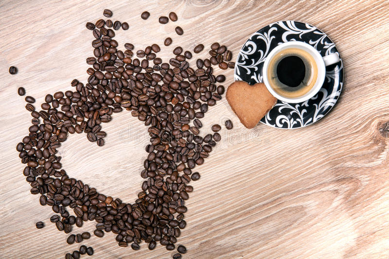 Download Heart Make Whit Coffee Beans And Cup Whit Espresso And Sweet Heart Cookie On Wood Table Background. Stock Photo - Image: 83722697