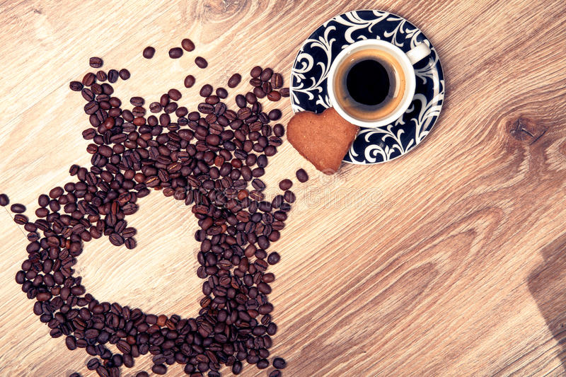 Download Heart Make Whit Coffee Beans And Cup Whit Espresso And Sweet Heart Cookie On Wood Table Background. Stock Image - Image: 83722997