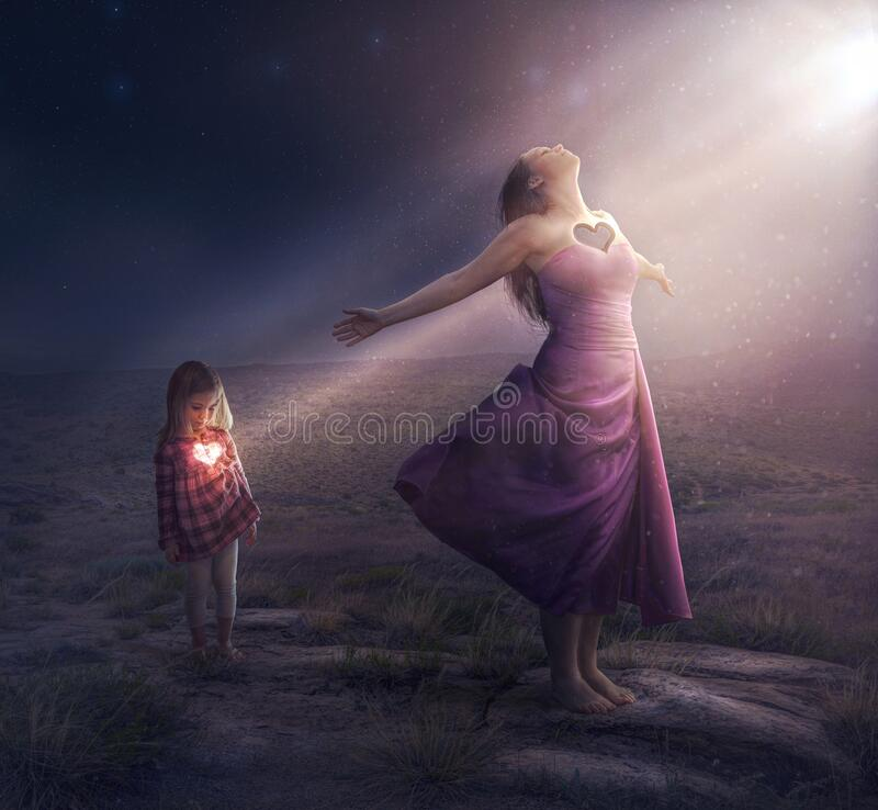 Heart of a Mother. A mother and daughter with light shining through the heart stock photography