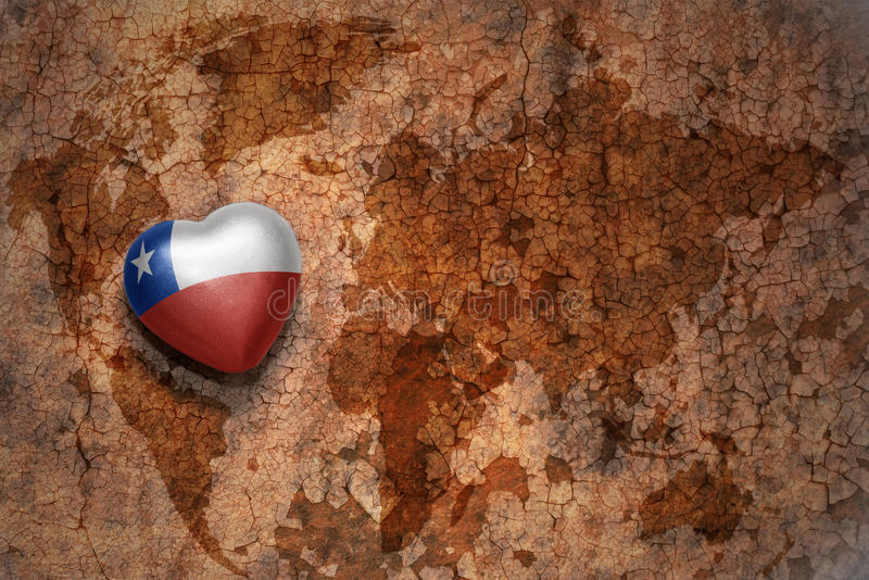 Heart with national flag of chile on a vintage world map crack paper background. royalty free stock photos