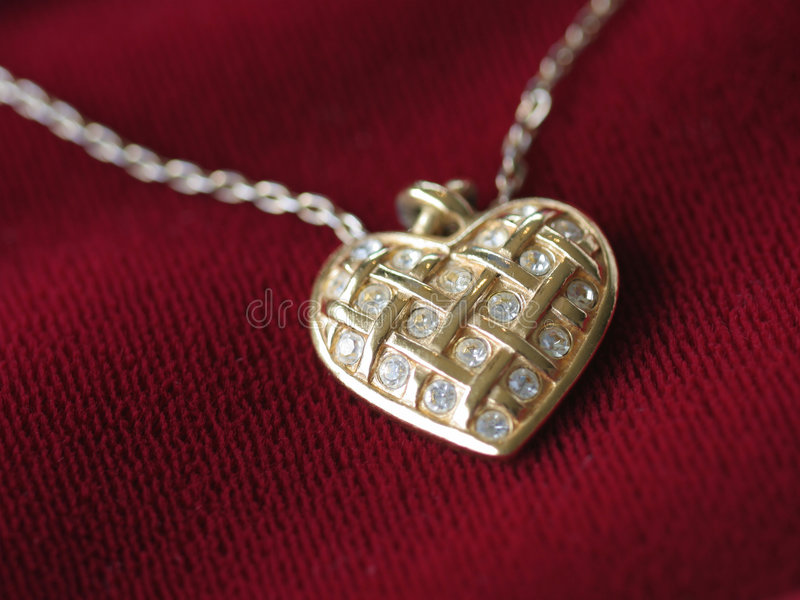 Heart necklace on red royalty free stock photos