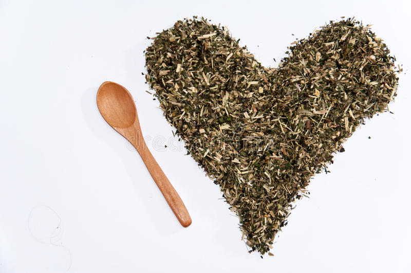 Heart of nettle tea on the white background.  royalty free stock image