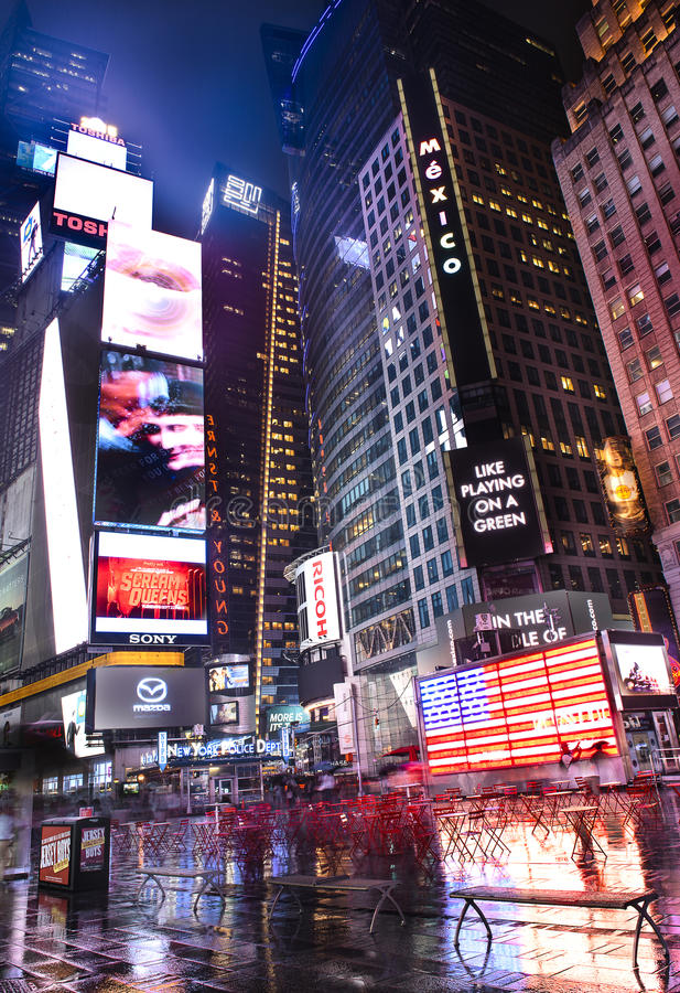 In the heart of New-York. NEW YORK CITY -JULY 09: Times Square, featured with Broadway Theaters and animated LED signs, is a symbol of New York City and the royalty free stock image