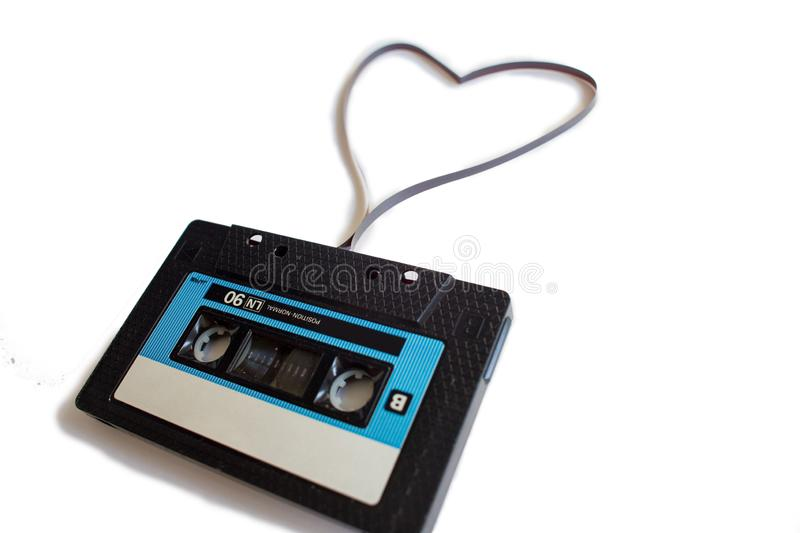 Heart from an old recorder cassette tape on a white background.  royalty free stock image