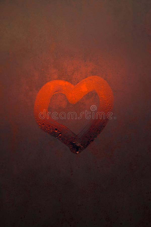 The heart is painted on the misted glass stock photo