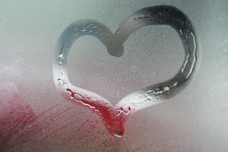 Heart painted on the window glass background royalty free stock photography