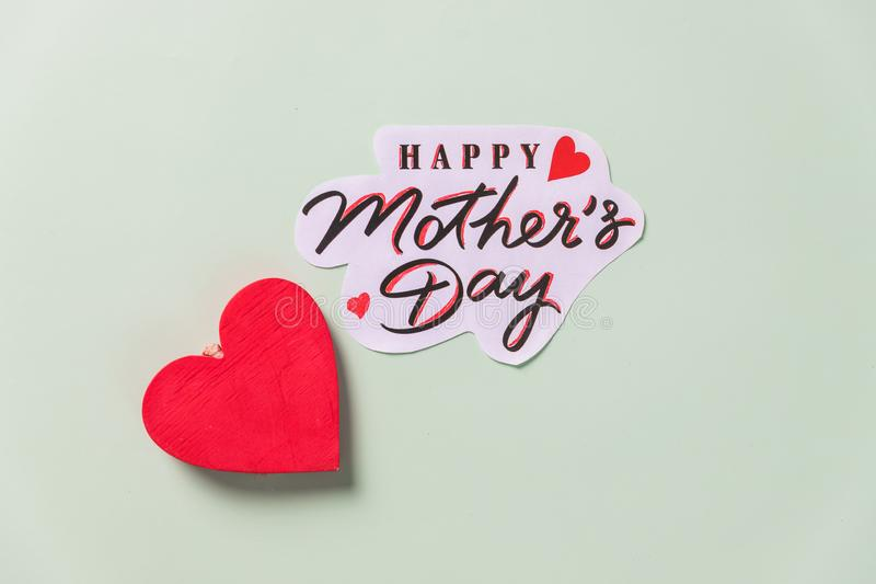 Heart on pastel background with Happy Mothers Day message.invitations, posters, banners, seasonal greetings.Happy Mother`s Day stock photography