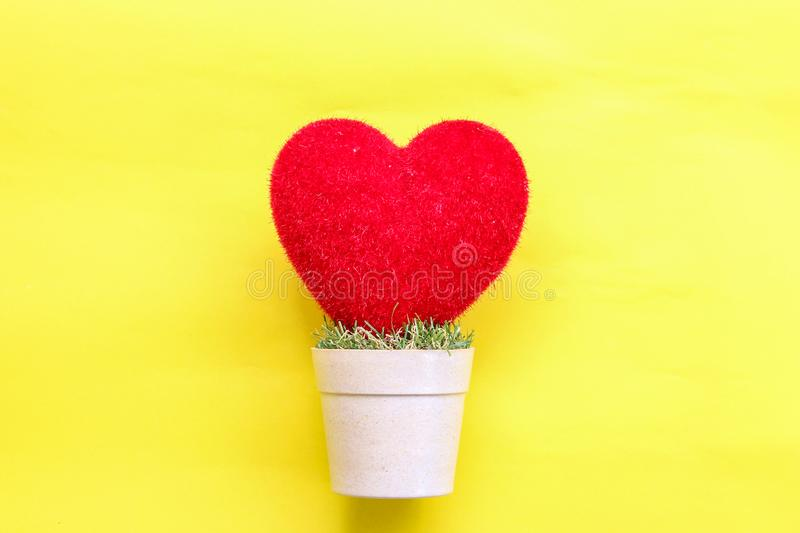 Heart on and pastel paper background stock image