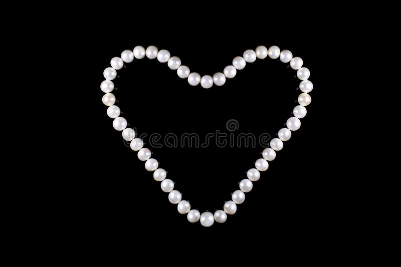 Heart of pearl beads. Isoladet royalty free stock image