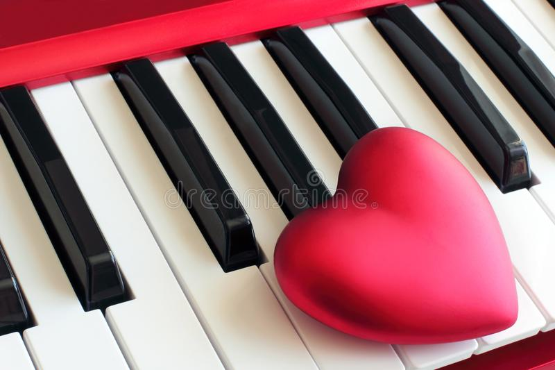 Love heart on piano keyboard. Black and white piano keys with a love heart above the keys as a concept of love or love to music stock images