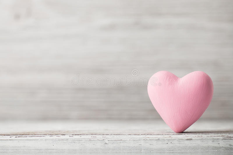 Heart. Pink heart on the wooden background. Provencal style royalty free stock photography