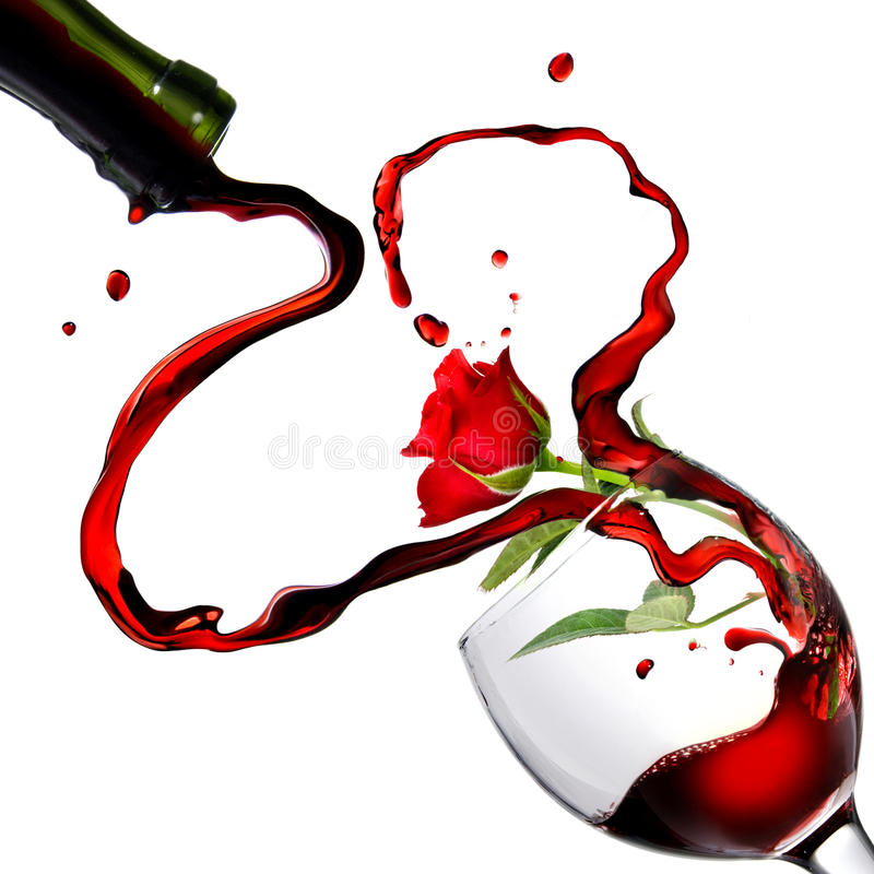 Heart from pouring red wine in goblet royalty free stock photo