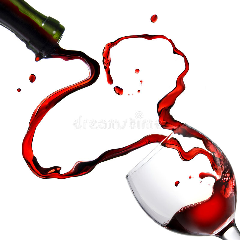 Heart from pouring red wine in goblet. Pouring red wine for valentine's day isolated on white royalty free stock image