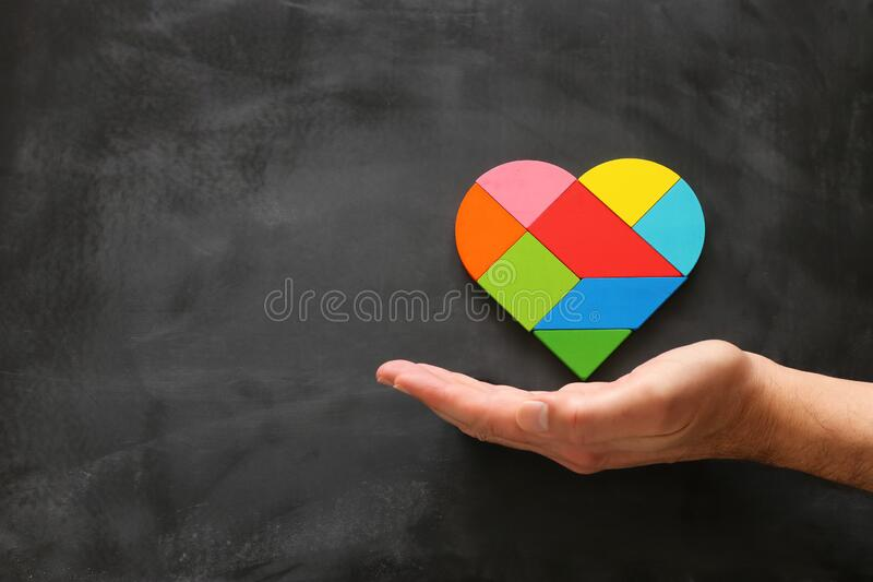 Heart puzzle on blackboard background.  stock image