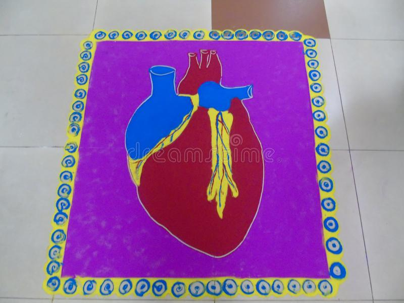 HEART RANGOLI BY NURCES IN BHILAI. HEART RANGOLI BY NURCES OCCATION OF NATIONAL DAY IN BHILAI NAGAR royalty free stock image