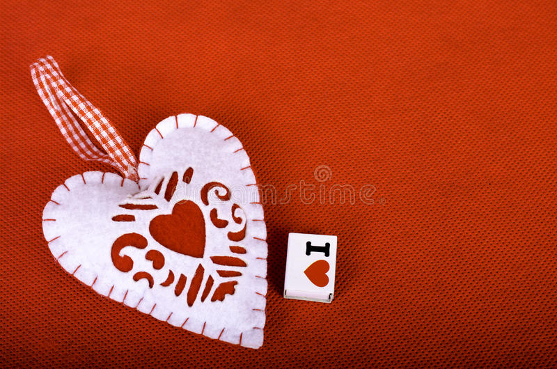 Heart on a red background. royalty free stock photo