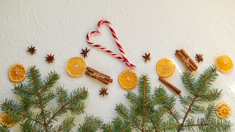 Heart of red candy cones with traditional spices for mulled wine – anise stars, cinnamon sticks, dried oranges. New year food royalty free stock photography