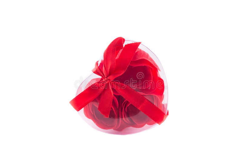 Heart of red roses with bows. Heart of red roses on a white background royalty free stock photos