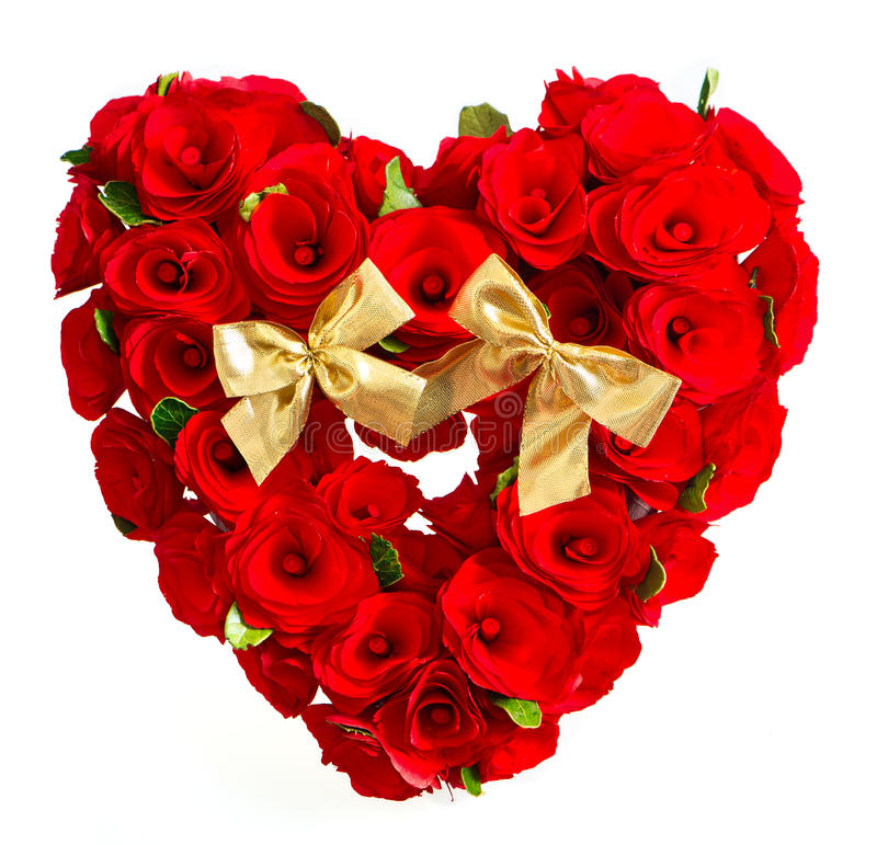 Heart of red roses with golden bow. On white background stock images