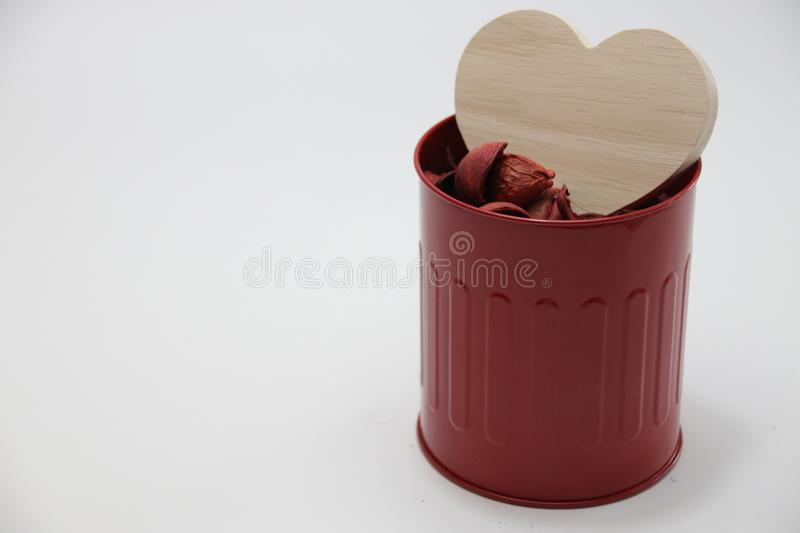A Heart and Red Roses Petals in Red Can. Pink Heart and red Rose Petals on White Back ground stock image