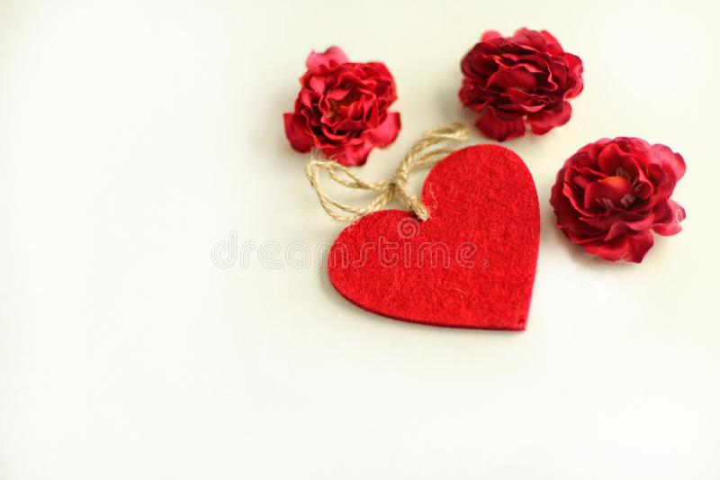 Heart and red roses on the white background. Evil eyes blue background protection design home decoration view colorful gift card heart red roses white royalty free stock photo