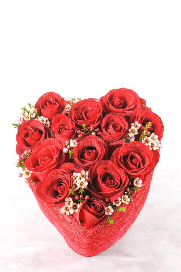 Heart of red roses on white. Background stock photo